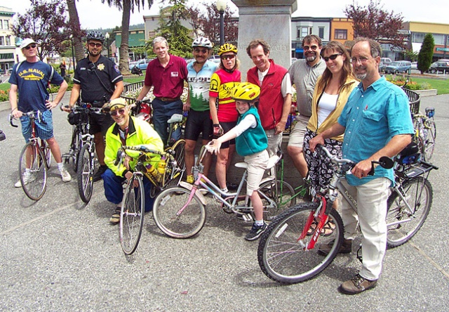 Skot Pascha; in yellow jacket with Mayor Bob Ornelas in white bike helmet   and  Arcata cyclists